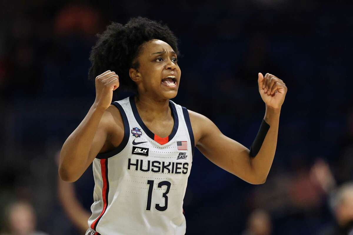 SAN ANTONIO, TEXAS - APRIL 02: Christyn Williams #13 of the UConn Huskies reacts against the Arizona Wildcats during the second quarter in the Final Four semifinal game of the 2021 NCAA Women's Basketball Tournament at the Alamodome on April 02, 2021 in San Antonio, Texas. (Photo by Elsa/Getty Images)