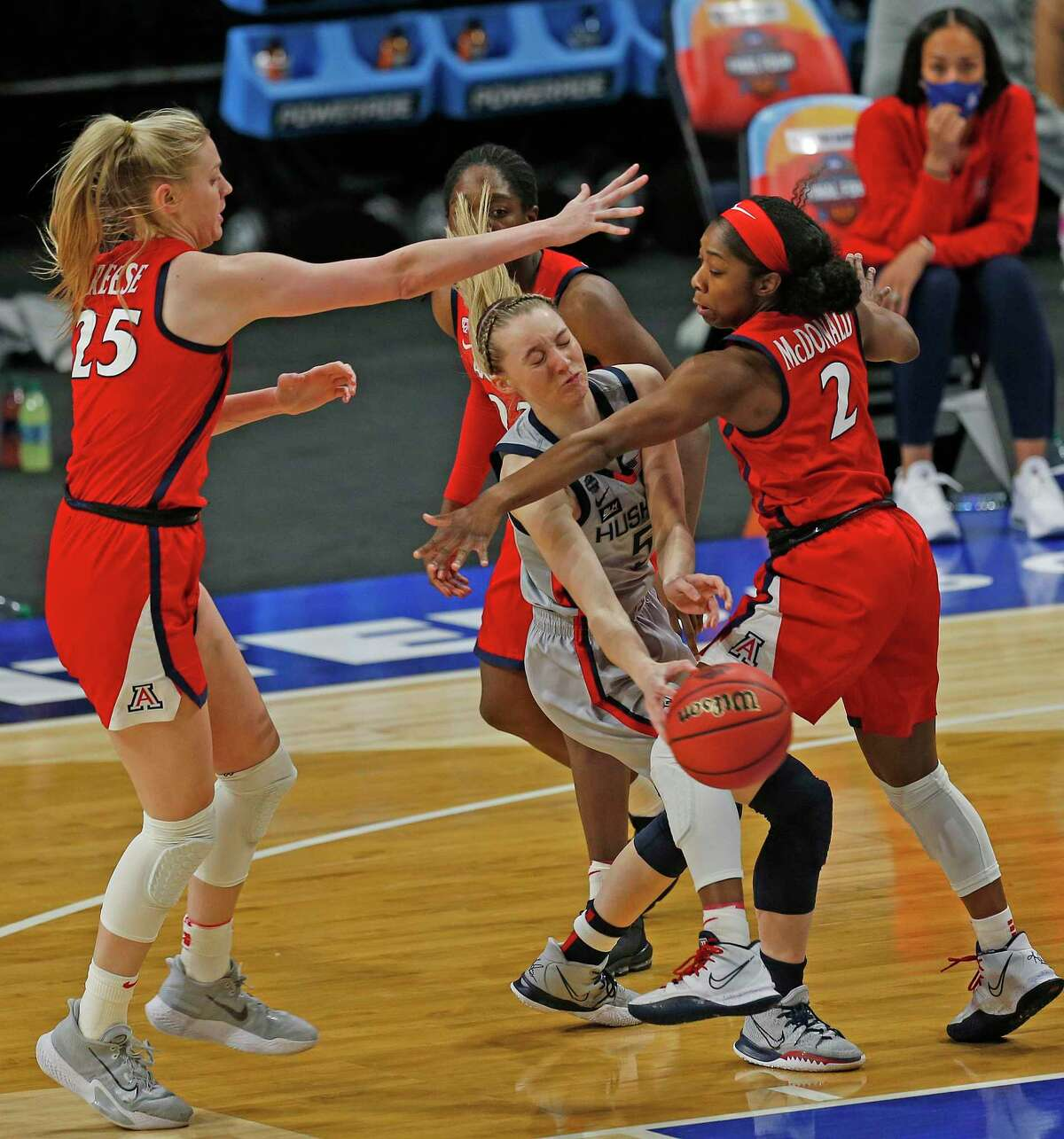 UConn guard Paige Bueckers (5) is trapped by Arizona guard Aari McDonald (2) and Arizona forward Cate Reese (25) in the first half on Friday, April 2, 2021 at the Alamodome.