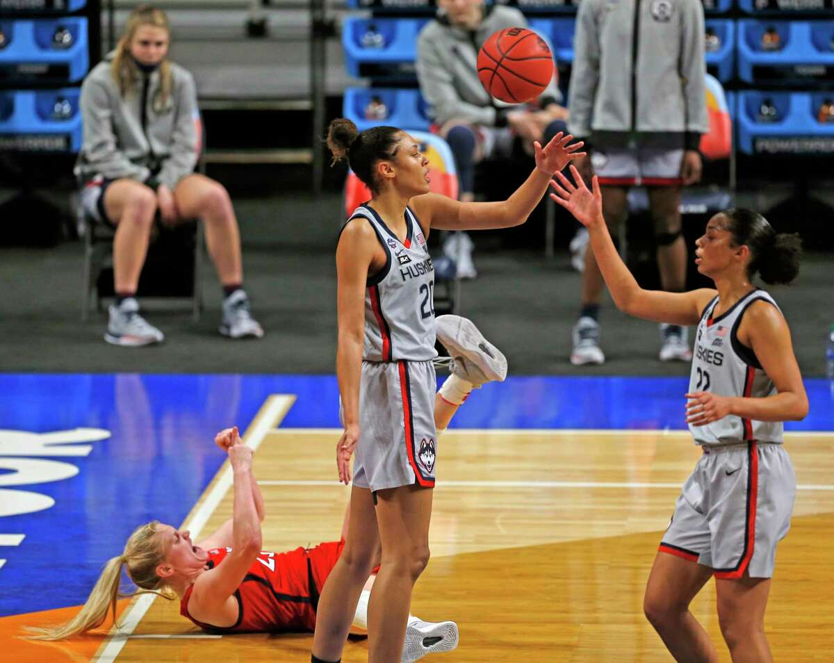 Arizona forward Cate Reese (25) celebrates after a basket and foul form UConn forward Olivia Nelson-Ododa (20) in the first half on Friday, April 2, 2021 at the Alamodome.