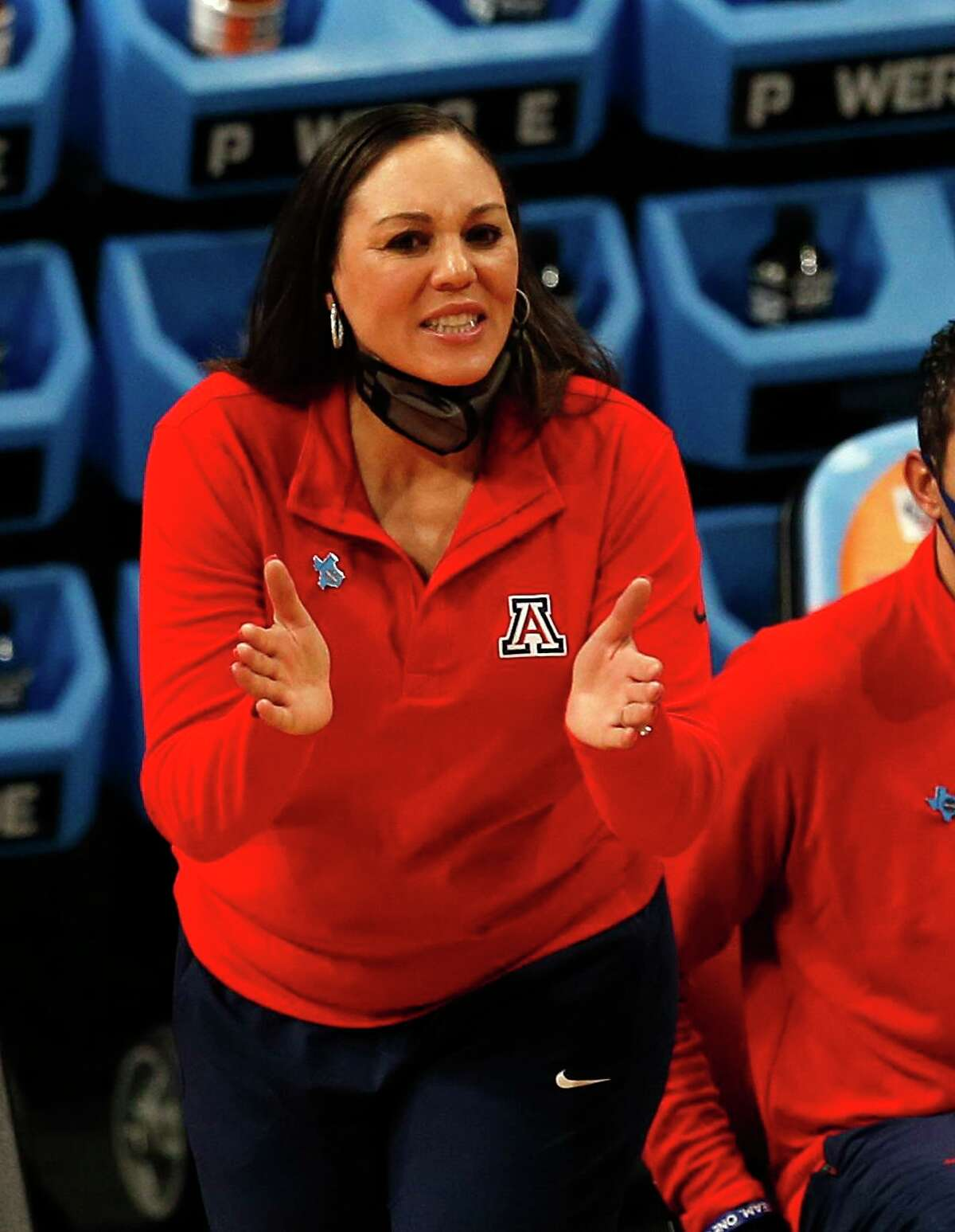 Arizona head coach Adia Barnes cheers on her team in the first half on Friday, April 2, 2021 at the Alamodome.