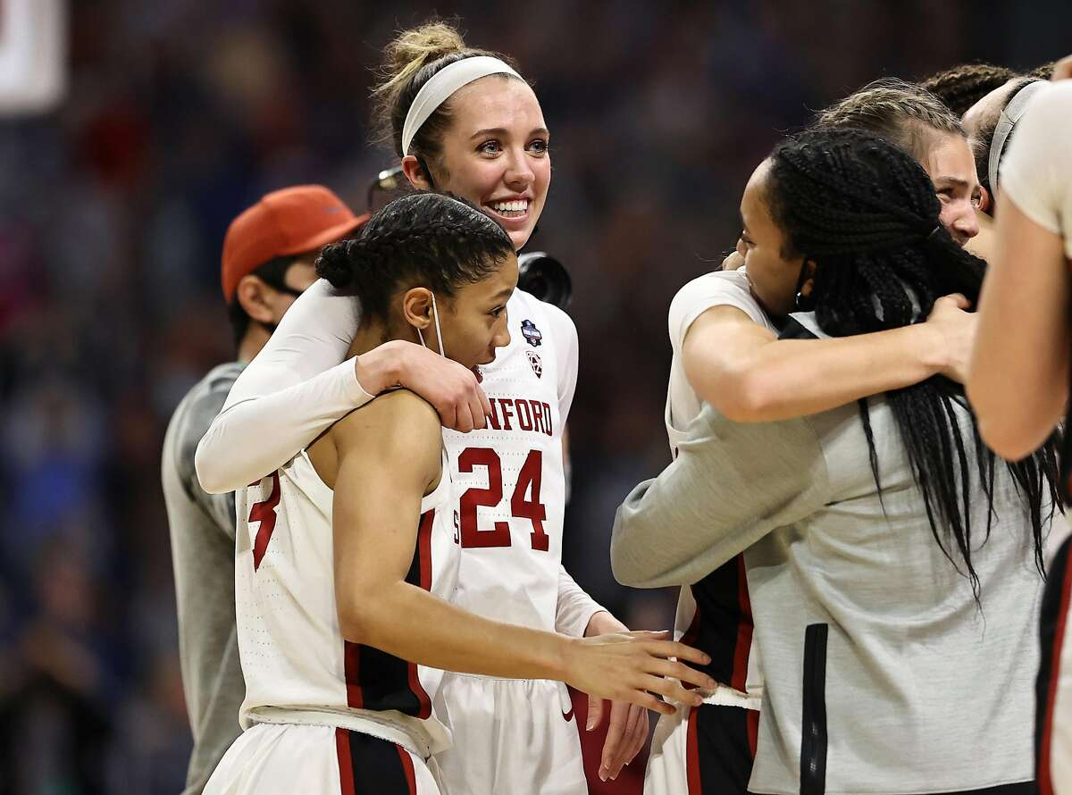 SAN ANTONIO, TEXAS - APRIL 02: Lacie Hull #24 of the Stanford Cardinal and Anna Wilson #3 of the Stanford Cardinal celebrate after defeating the South Carolina Gamecocks in the Final Four semifinal game of the 2021 NCAA Women's Basketball Tournament at the Alamodome on April 02, 2021 in San Antonio, Texas. (Photo by Elsa/Getty Images)