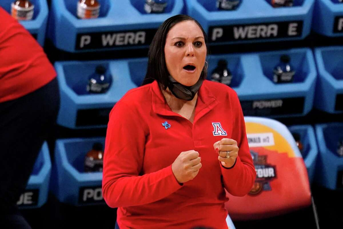 Arizona head coach Adia Barnes reacts during the first half of a women's Final Four NCAA college basketball tournament semifinal game against Connecticut Friday, April 2, 2021, at the Alamodome in San Antonio. (AP Photo/Eric Gay)