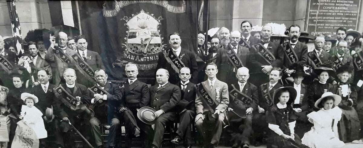The San Antonio Division 1 of the Ancient Order of Hibernians stands in front of St, Mary's Catholic Church in 1908. Traditionally the parish for Irish-American and other English-speaking Catholics, St. Mary's hosted the Hibernians' annual St. Patrick's Day Masses for many years. Well-known saloon-keeper Gilbert Ryan O'Shaughnessy (center, light-gray suit) was the group's president in 1908.
