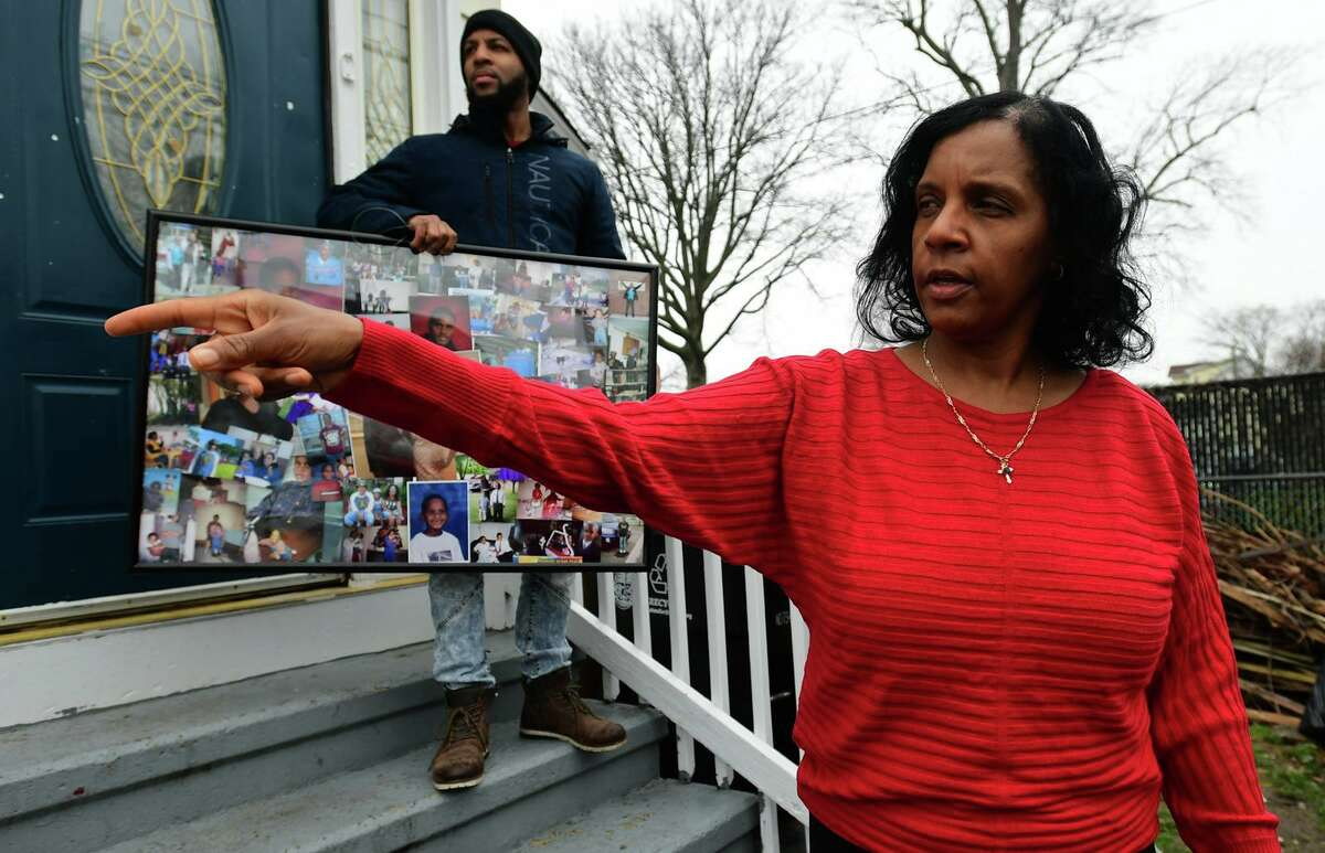 Valerie Jaddo and her son Shane Aaron stand outside her home in Stamford on . As a part of a lawsuit filed last week, Jaddo is asking the city to reform how it responds to mental health/psychiatric calls after an incident with her other son.