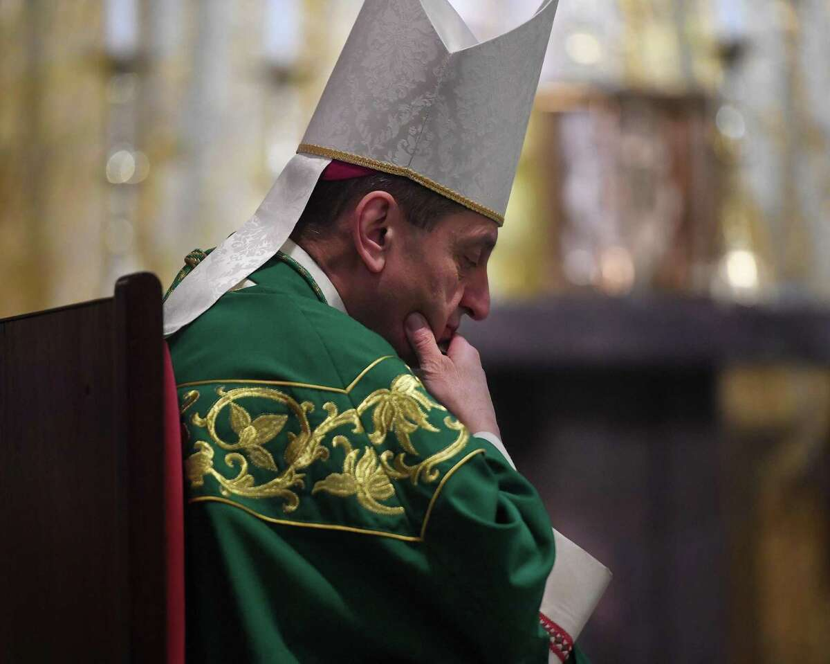 Bishop Frank Caggiano bows his head in prayer during a bilingual Mass in Italian and English to honor Mother Cabrini, the first Italian-American canonized saint, at Sacred Heart Church in Stamford, Connecticut, on Sunday, Nov. 17, 2019.