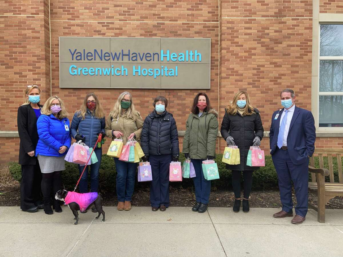 The new chapter of the Daughters of the American Revolution recently brought a sweet treat to Greenwich Hospital, bags of donated candy. From left, Karen Santucci, Julie Lapin, DAR members Nan Levy, Jenny Larkin, Wendy Dziurzynski, Karen Popp, Jane Tranfo and Greenwich Hospital's Marc Kosak all posed together before the candy was given out to hospital employees.