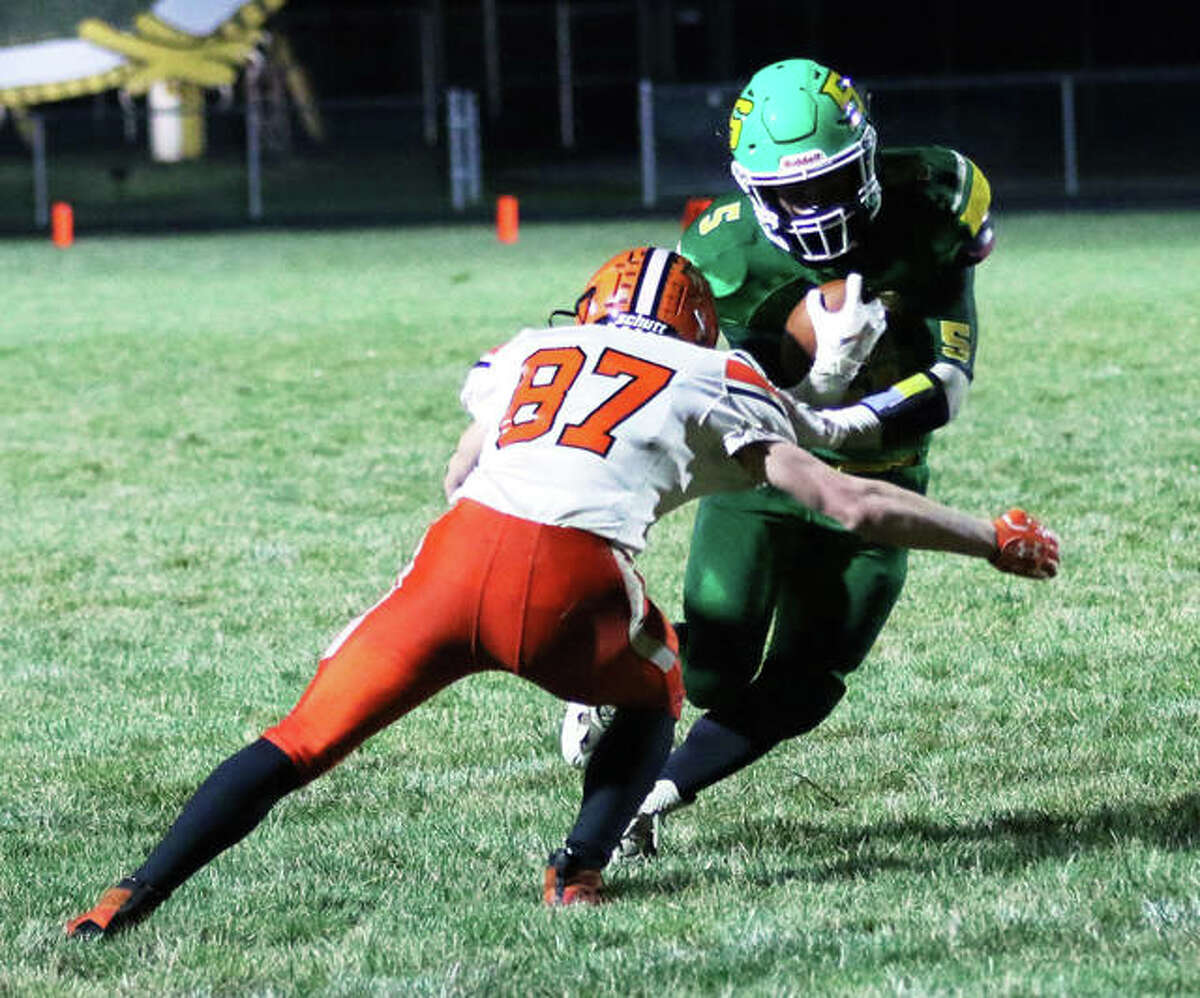Southwestern RB Gavin Day, shown taking a hit from Gillespie's Tanner Whitfield (87) in a Week 2 game in Piasa, rushed for 131 yards Friday night to lead the Piasa Birds to a win over Vandalia. Southwestern is 3-0 for the first time since 2002.