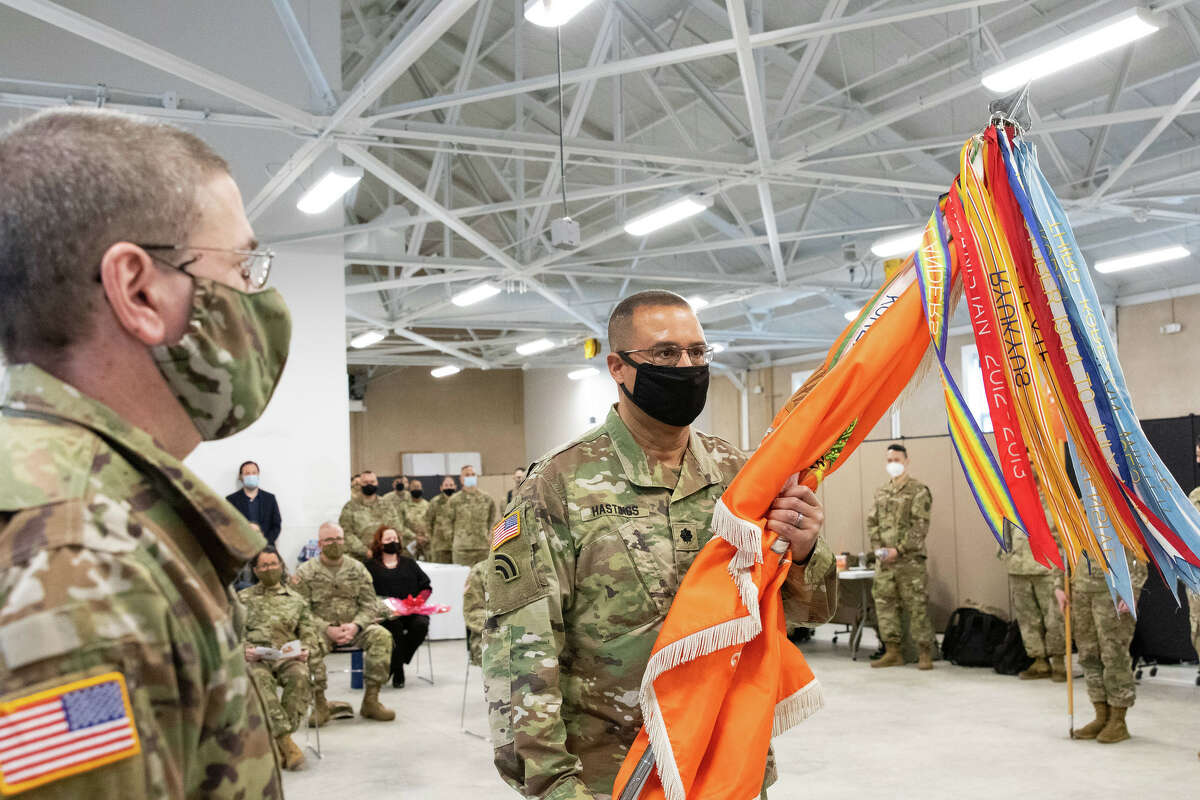 New York Army National Guard Lt. Col. Michael J. Hastings, accepts the unit flag of the 101st Expeditionary Signal Battalion during change of command ceremonies at ceremony at Camp Smith, near Peekskill.