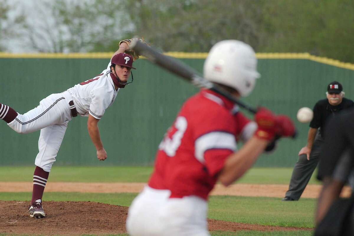 Pearland's Garrett Coiner (13) pitches to Dawson's Cayden Adamson (13) Tuesday, Mar. 30 in a District 23-6A baseball game at Pearland High School.
