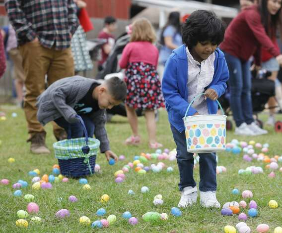 Kishan Angeletti, right, looks for colorful eggs during 7 Acre Woods'€™ annual Easter egg hunt and vendors market, Saturday, April 3, 2021, in Conroe. Photo: Jason Fochtman/Staff Photographer / 2021 © Houston Chronicle