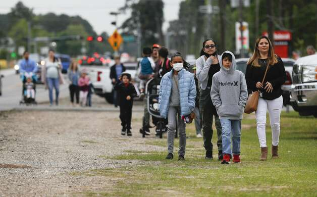 Guest make their way toward 7 Acre Woods for the annual Easter egg hunt and vendors market, Saturday, April 3, 2021, in Conroe. Photo: Jason Fochtman/Staff Photographer / 2021 © Houston Chronicle