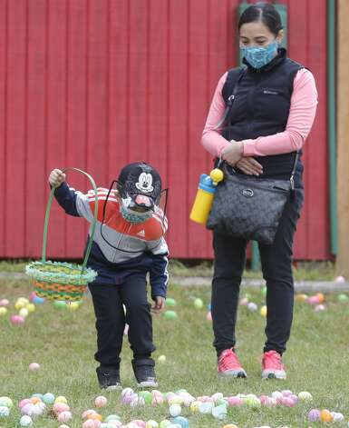 Jed DD picks up eggs as he and his family visit 7 Acre Woods for its annual Easter egg hunt and vendors market, Saturday, April 3, 2021, in Conroe. Photo: Jason Fochtman/Staff Photographer / 2021 ? Houston Chronicle