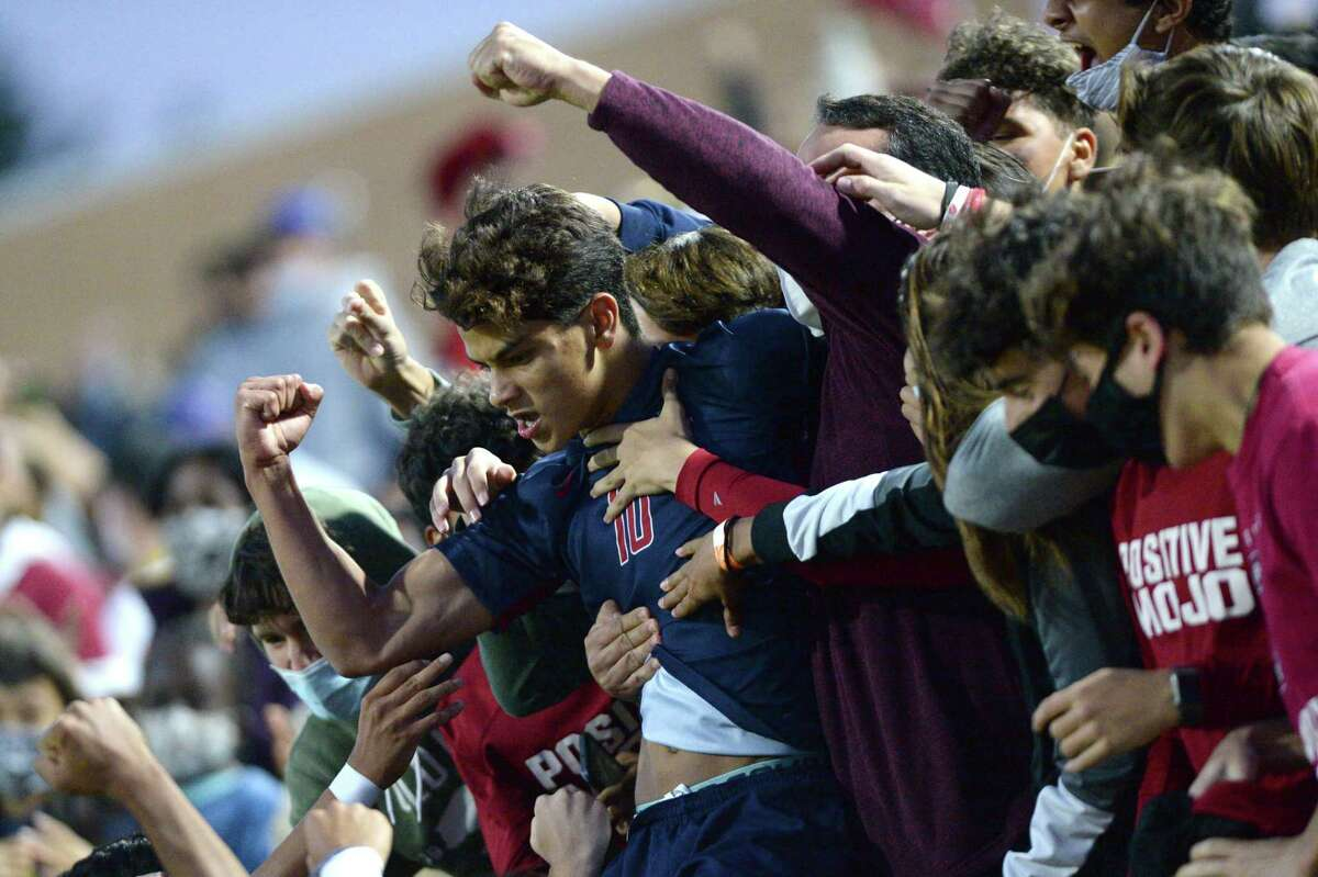 Luis Lugo (10) of Tompkins celebrates with fans after his goal during the first half of a 6A-III regional quarterfinal soccer match between the Seven Lakes Spartans and the Tompkins Falcons on Friday, April 2, 2021 at Legacy Stadium, Katy, TX.