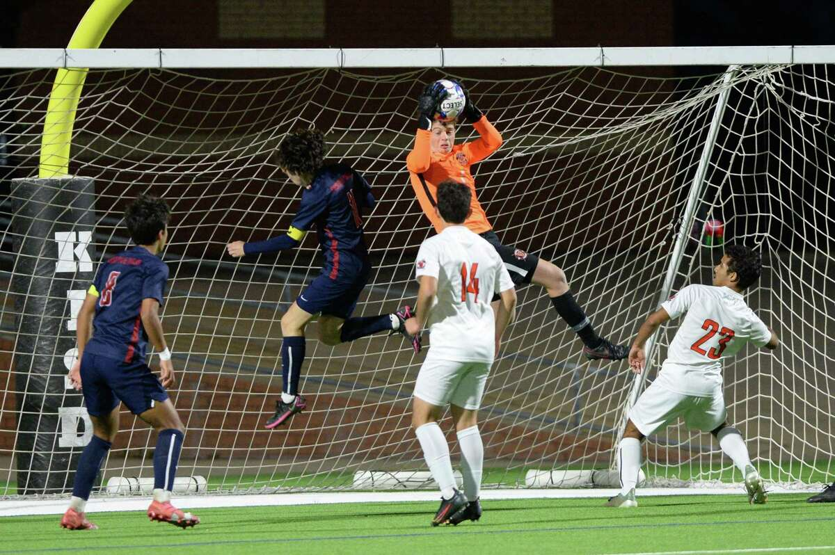 Goalkeeper Sean Paxton (1) of Seven Lakes makes a save during the first half of a 6A-III regional quarterfinal soccer match between the Seven Lakes Spartans and the Tompkins Falcons on Friday, April 2, 2021 at Legacy Stadium, Katy, TX.