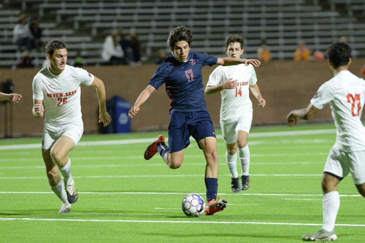 Sam Garcia (17) of Tompkins passes a ball during the first half of a 6A-III regional quarterfinal soccer match between the Seven Lakes Spartans and the Tompkins Falcons on Friday, April 2, 2021 at Legacy Stadium, Katy, TX.
