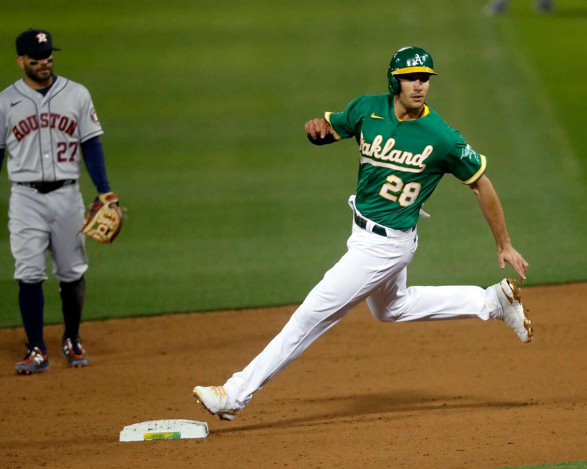 Oakland Athletics' Matt Olson advances to second base on a wild pitch by Houston Astros i9n 6th inning during MLB game at Oakland Coliseum in Oakland, Calif., on Friday, April 2, 2021.