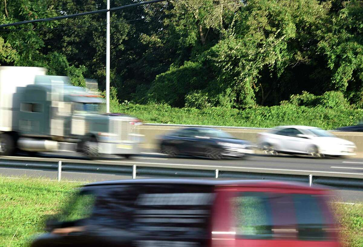 Evening rush hour traffic moves along I-95 near Exit 4 in the Cos Cob section of Greenwich, Conn. Wednesday, Oct. 3, 2018.