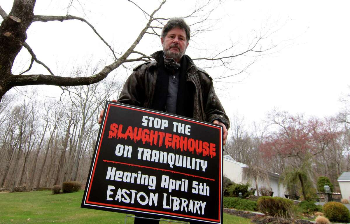 Neighbors on Tranquility Drive led by Joseph Calzone, pictured, are fighting a proposed commercial chicken coop and slaughterhouse in their neighborhood in Easton, Conn., on Friday April 2, 2021.