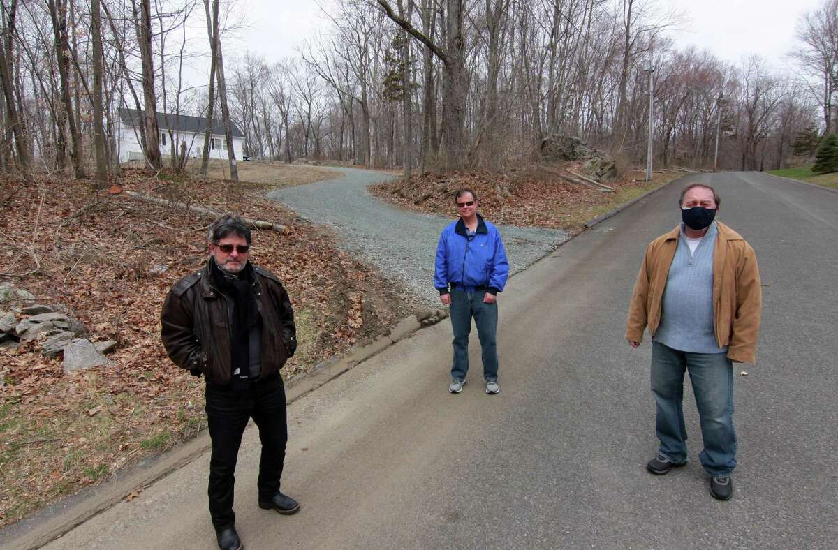 Neighbors on Tranquility Drive led by Joseph Calzone, left, are fighting a proposed commercial chicken coop and slaughterhouse in their neighborhood in Easton, Conn., on Friday April 2, 2021.
