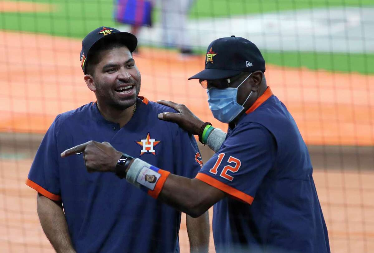 Houston Astros manager Dusty Baker Jr. jokes around with Houston Astros starting pitcher Jose Urquidy (65) during batting practice before the start of an MLB baseball game at Minute Maid Park, Wednesday, September 16, 2020, in Houston.