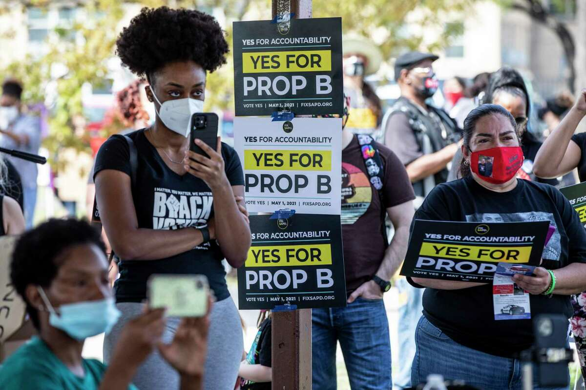 People attend a rally at Pittman-Sullivan Park to support Proposition B, which would strip the San Antonio police union of its power to bargain for a contract.