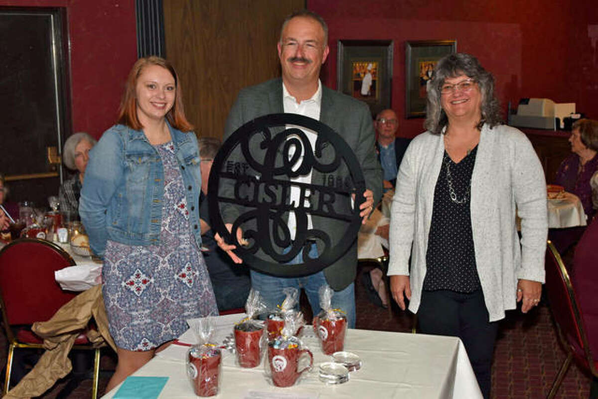 Pictured atr the presentation of a 30-year anniversary gift are, from left, Cassie Beesley, David Cisler and Paula Walkington.