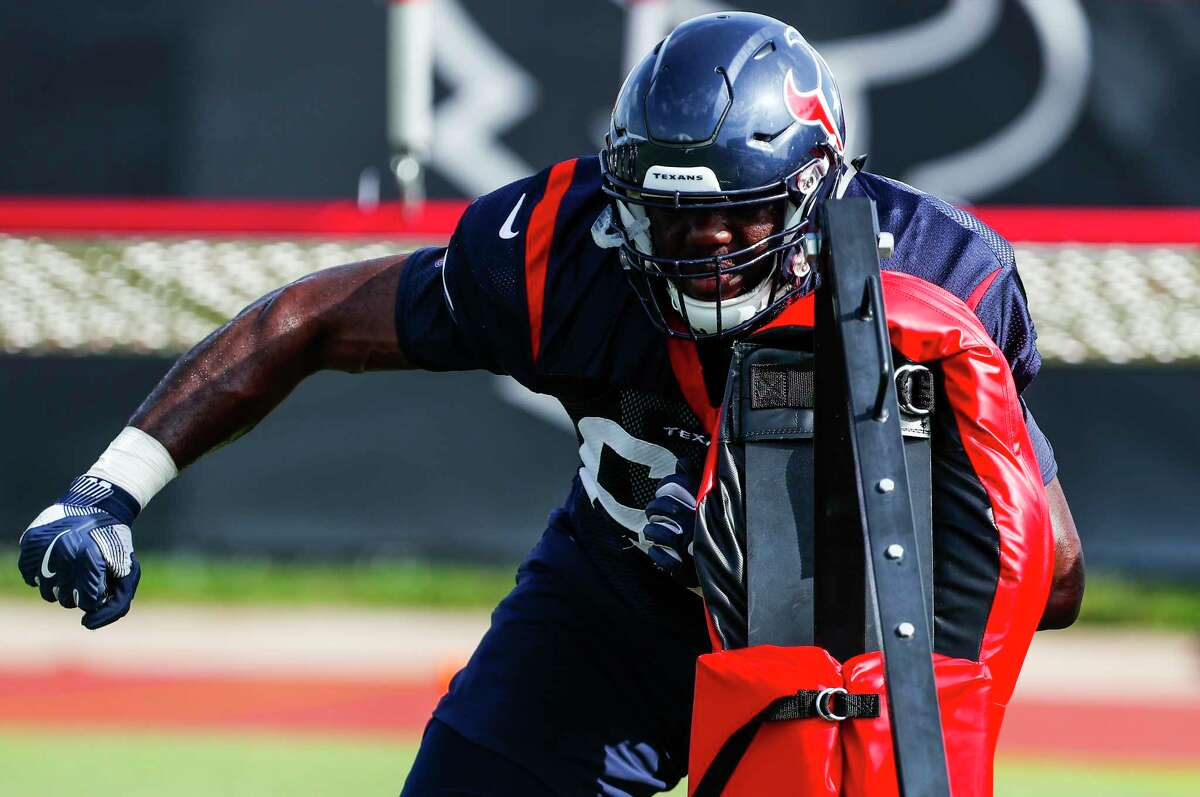 Houston Texans offensive tackle Roderick Johnson (63) hits a blocking sled during training camp at the Methodist Training Center on Tuesday, Aug. 14, 2018, in Houston.