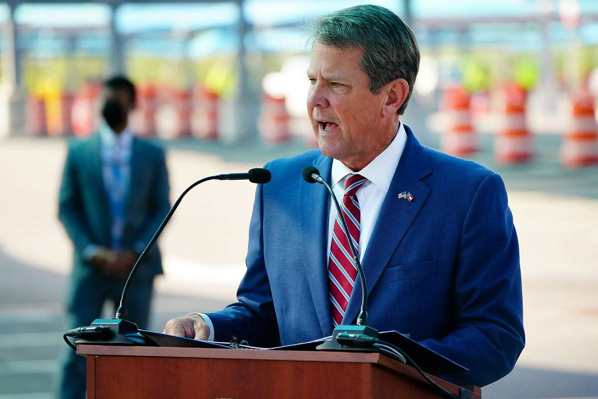 """Gov. Brian Kemp on Saturday warned that Kemp warned that the """"cancel culture"""" and partisan activists would target other events and businesses. File photo. (Elijah Nouvelage/Getty Images/TNS)"""