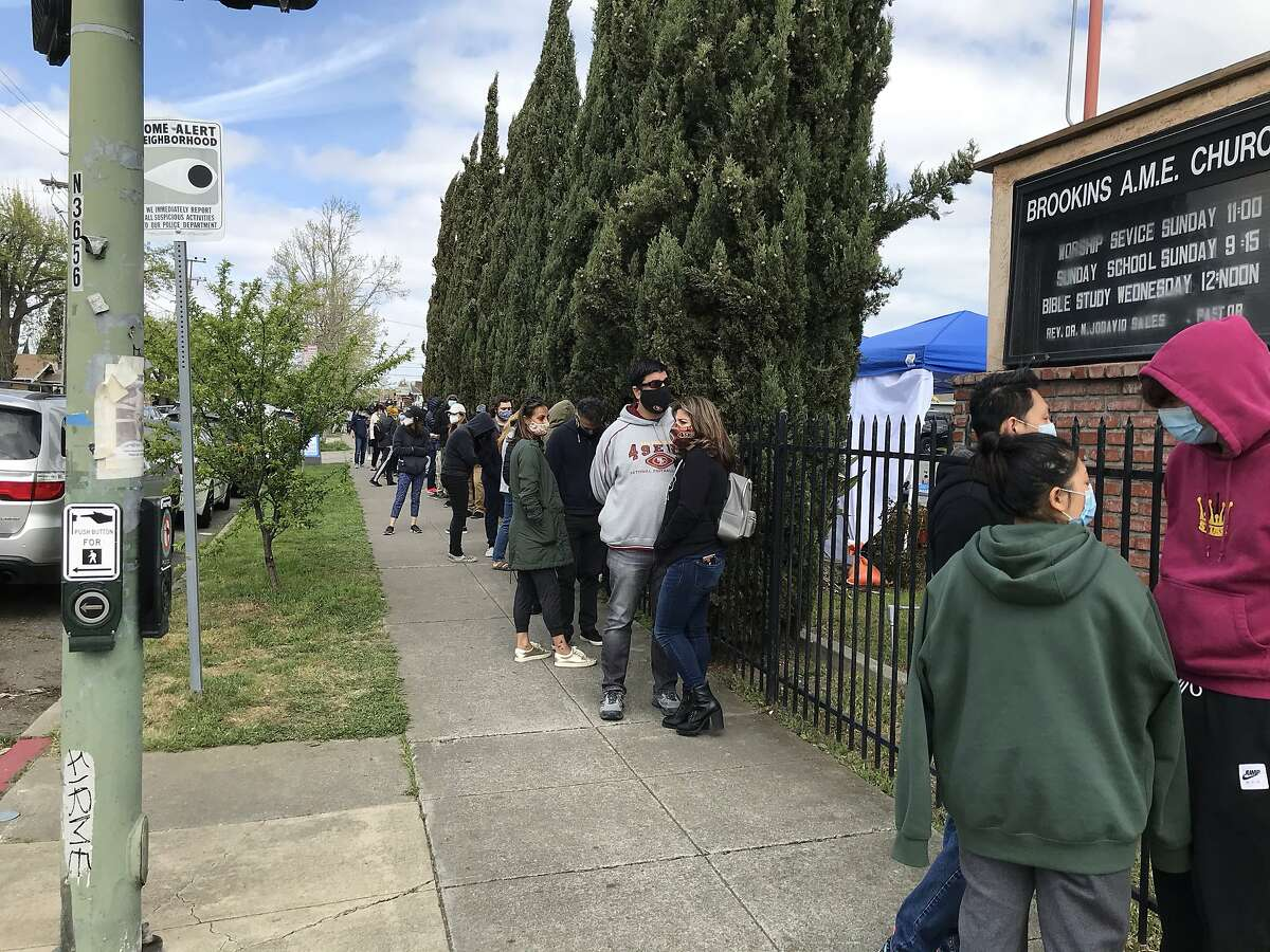 Hundreds of people show up for COVID vaccinations during a four-day pop-up clinic at Brookins AME Church in East Oakland.