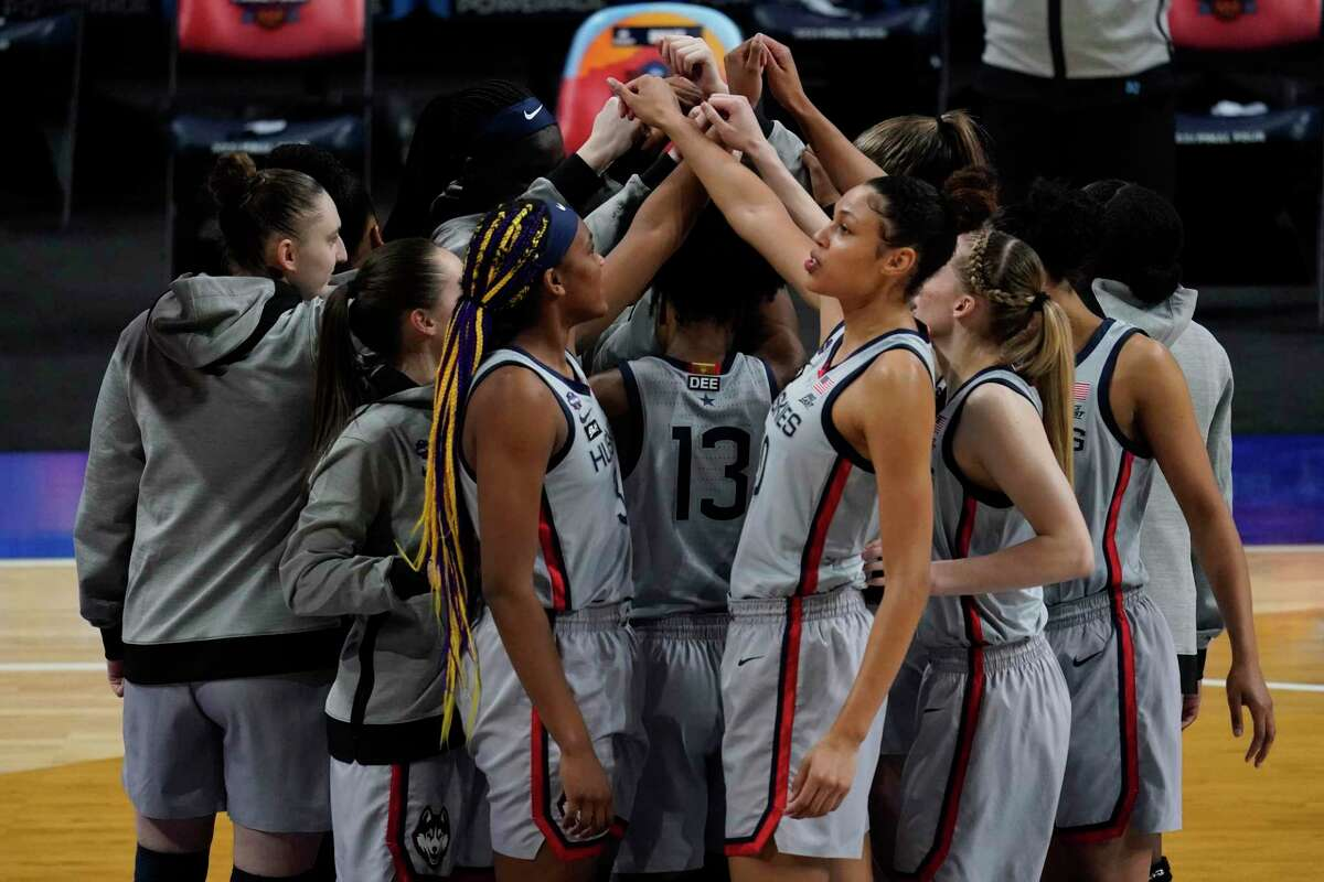 UConn players huddle before their Final Four game against Arizona on Friday at the Alamodome in San Antonio.