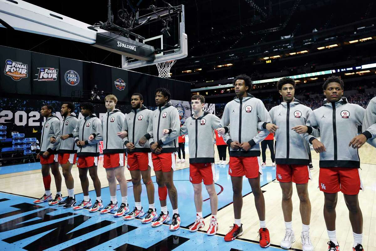 INDIANAPOLIS, INDIANA - APRIL 03: The Houston Cougars stand on the court during the national anthem before the 2021 NCAA Final Four semifinal against the Baylor Bears at Lucas Oil Stadium on April 03, 2021 in Indianapolis, Indiana.
