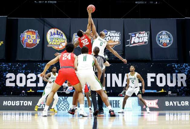 INDIANAPOLIS, INDIANA - APRIL 03: Reggie Chaney #32 of the Houston Cougars and Flo Thamba #0 of the Baylor Bears compete for the opening tip-off during the 2021 NCAA Final Four semifinal at Lucas Oil Stadium on April 03, 2021 in Indianapolis, Indiana. Photo: Jamie Squire, Getty Images / 2021 Getty Images