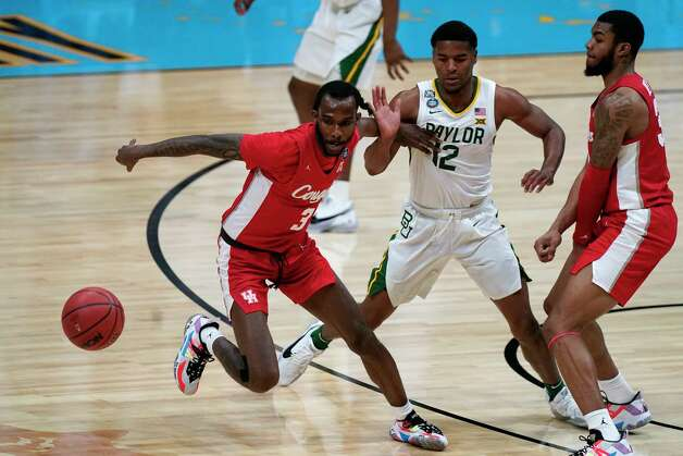 Houston guard DeJon Jarreau (3) runs down a loose ball ahead of Baylor guard Jared Butler (12) during the first half of a men's Final Four NCAA college basketball tournament semifinal game, Saturday, April 3, 2021, at Lucas Oil Stadium in Indianapolis. (AP Photo/Michael Conroy) Photo: Michael Conroy, Associated Press / Copyright 2021 The Associated Press. All rights reserved.