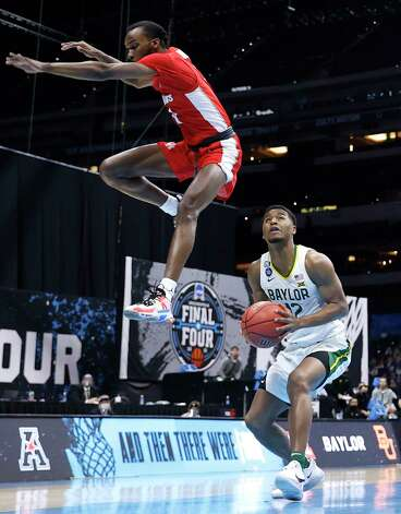 INDIANAPOLIS, INDIANA - APRIL 03: DeJon Jarreau #3 of the Houston Cougars jumps over Jared Butler #12 of the Baylor Bears in the first half during the 2021 NCAA Final Four semifinal at Lucas Oil Stadium on April 03, 2021 in Indianapolis, Indiana. Photo: Jamie Squire, Getty Images / 2021 Getty Images