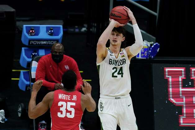 Baylor guard Matthew Mayer (24) shoots over Houston forward Fabian White Jr. (35) during the first half of a men's Final Four NCAA college basketball tournament semifinal game, Saturday, April 3, 2021, at Lucas Oil Stadium in Indianapolis. (AP Photo/Michael Conroy) Photo: Michael Conroy, Associated Press / Copyright 2021 The Associated Press. All rights reserved.