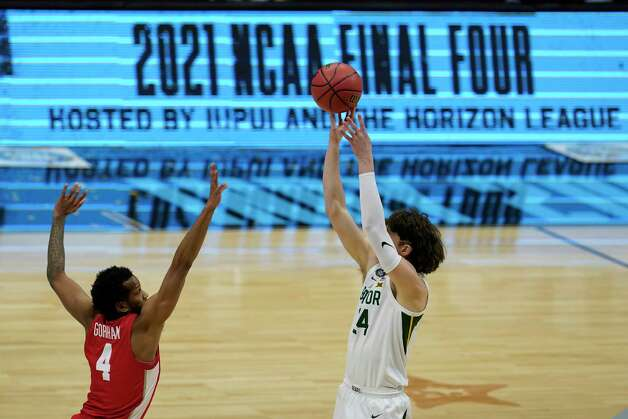 Baylor guard Matthew Mayer (24) shoots over Houston forward Justin Gorham (4) during the first half of a men's Final Four NCAA college basketball tournament semifinal game, Saturday, April 3, 2021, at Lucas Oil Stadium in Indianapolis. (AP Photo/Michael Conroy) Photo: Michael Conroy, Associated Press / Copyright 2021 The Associated Press. All rights reserved.