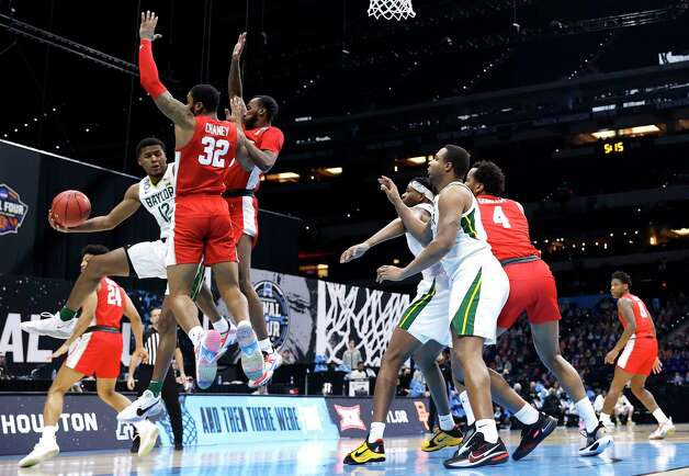 INDIANAPOLIS, INDIANA - APRIL 03: Jared Butler #12 of the Baylor Bears handles the ball as he is defended by Reggie Chaney #32 and DeJon Jarreau #3 of the Houston Cougars in the first half during the 2021 NCAA Final Four semifinal at Lucas Oil Stadium on April 03, 2021 in Indianapolis, Indiana. Photo: Jamie Squire, Getty Images / 2021 Getty Images