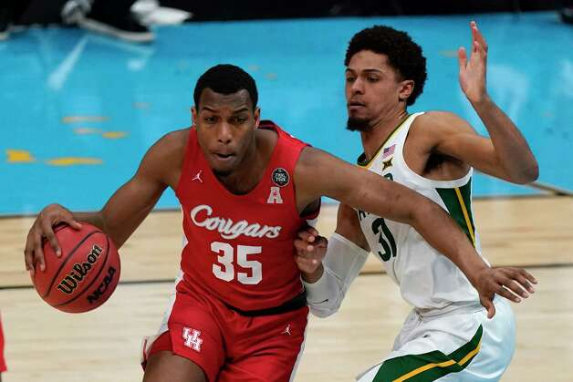 Houston forward Fabian White Jr. (35) drives around Baylor guard MaCio Teague, right, during the first half of a men's Final Four NCAA college basketball tournament semifinal game, Saturday, April 3, 2021, at Lucas Oil Stadium in Indianapolis. (AP Photo/Michael Conroy) Photo: Michael Conroy, Associated Press / Copyright 2021 The Associated Press. All rights reserved.
