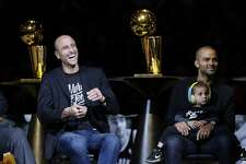 Former San Antonio Spurs guard Manu Ginobili, left, laughs with former teammate Tony Parker, right, during Parker's retirement ceremony after the team's NBA basketball game against the Memphis Grizzlies in San Antonio, Monday, Nov. 11, 2019. (AP Photo/Eric Gay)
