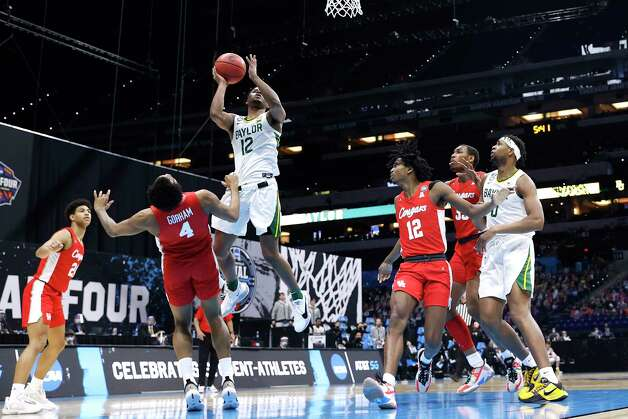 INDIANAPOLIS, INDIANA - APRIL 03: Jared Butler #12 of the Baylor Bears drives to the basket against Justin Gorham #4 of the Houston Cougars in the first half during the 2021 NCAA Final Four semifinal at Lucas Oil Stadium on April 03, 2021 in Indianapolis, Indiana. Photo: Jamie Squire, Getty Images / 2021 Getty Images
