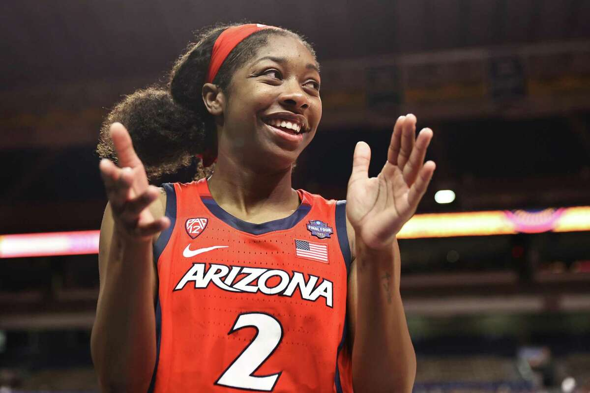 SAN ANTONIO, TEXAS - APRIL 02: Aari McDonald #2 of the Arizona Wildcats celebrates with teammates after defeating the UConn Huskies in the Final Four semifinal game of the 2021 NCAA Women's Basketball Tournament at the Alamodome on April 02, 2021 in San Antonio, Texas. (Photo by Elsa/Getty Images)