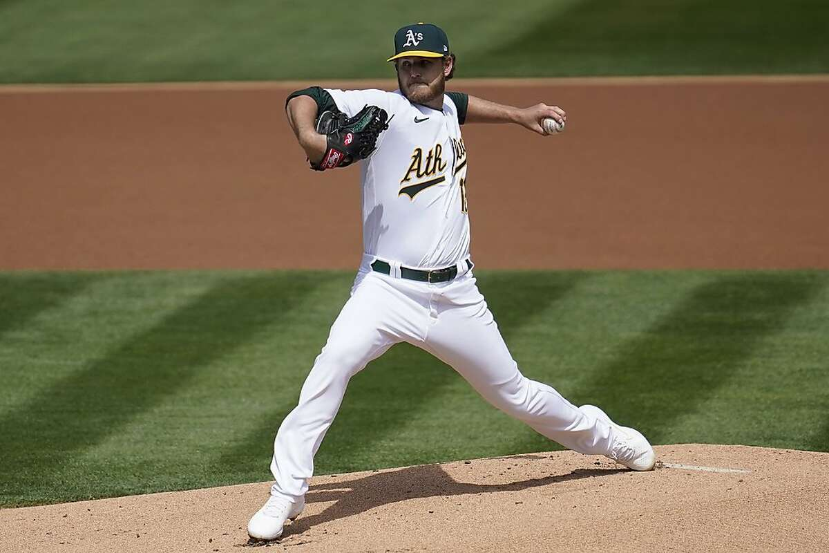 Oakland Athletics' Cole Irvin pitches against the Houston Astros during the first inning of a baseball game in Oakland, Calif., Saturday, April 3, 2021. (AP Photo/Jeff Chiu)