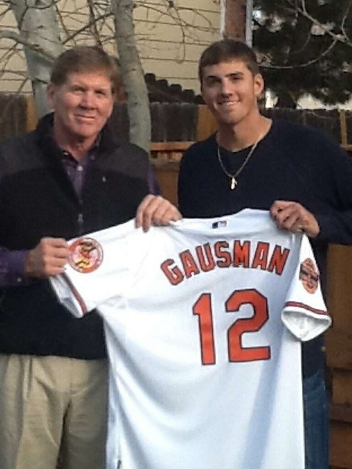 Clair Gausman, a college football replay official, flew to Seattle to watch his son Kevin pitch.