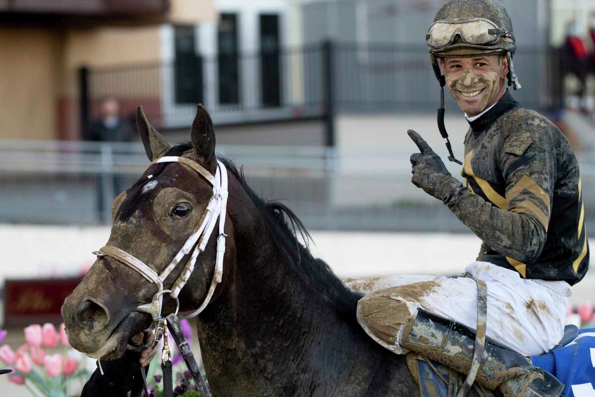 Jockey Kendrick Carmouche is all smiles as he brings Bourbonic to the winners circle in the 96th running of The Wood Memorial April 3, 2021 at Aqueduct Race Track in Queens, NY. Photo Special to the Times Union by Skip Dickstein