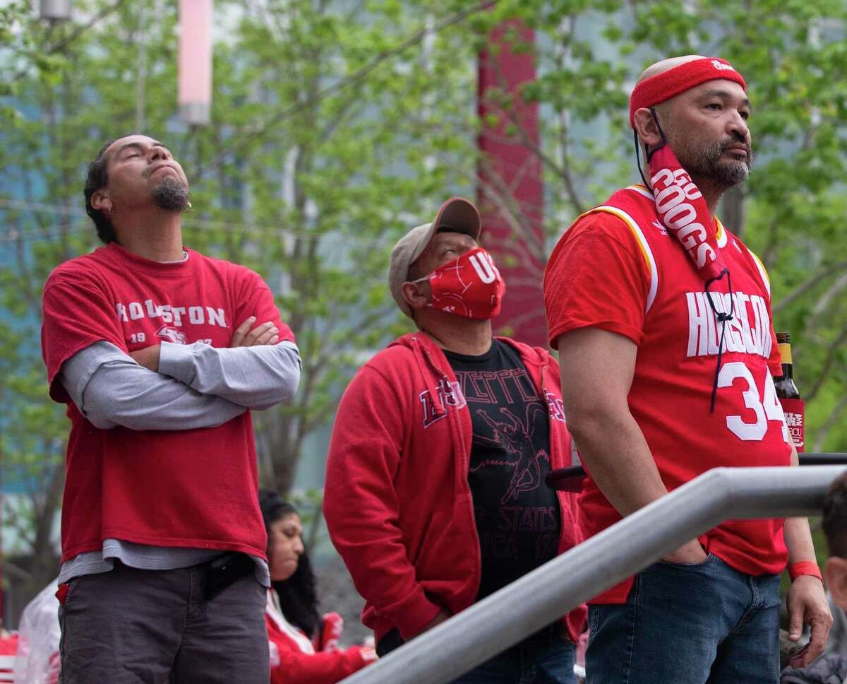 University of Houston alums Joaquin Gomez, from left, Danny Martinez and Alex Zarate react to the team's scoring drought during the first half of the Final Four game against Baylor University Saturday, April 3, 2021, at Avenida Houston in Houston.