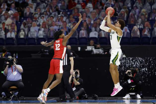 INDIANAPOLIS, INDIANA - APRIL 03: MaCio Teague #31 of the Baylor Bears shoots the ball against Tramon Mark #12 of the Houston Cougars in the second half during the 2021 NCAA Final Four semifinal at Lucas Oil Stadium on April 03, 2021 in Indianapolis, Indiana. (Photo by Jamie Squire/Getty Images) Photo: Jamie Squire/Getty Images / 2021 Getty Images