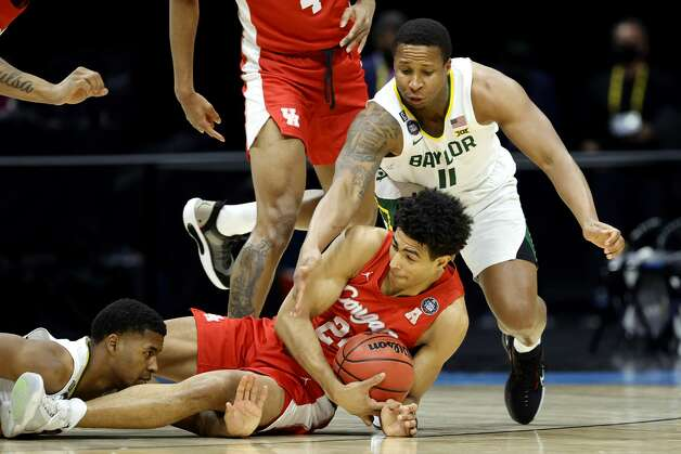 INDIANAPOLIS, INDIANA - APRIL 03: Quentin Grimes #24 of the Houston Cougars dives for a loose ball against Mark Vital #11 of the Baylor Bears in the first half during the 2021 NCAA Final Four semifinal at Lucas Oil Stadium on April 03, 2021 in Indianapolis, Indiana. (Photo by Tim Nwachukwu/Getty Images) Photo: Tim Nwachukwu/Getty Images / 2021 Getty Images
