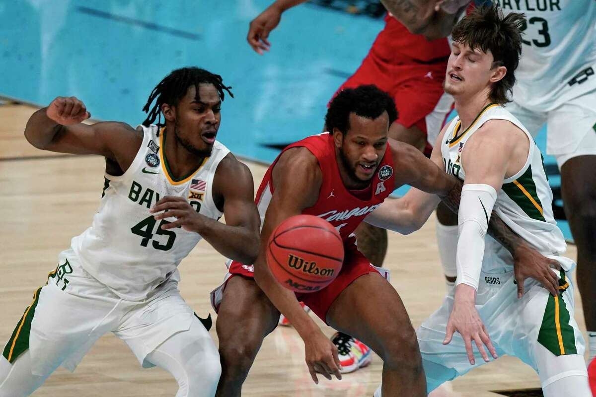 Houston forward Justin Gorham, center, loses the ball between Baylor guard Davion Mitchell (45) and guard Matthew Mayer, right, during the first half of a men's Final Four NCAA college basketball tournament semifinal game.