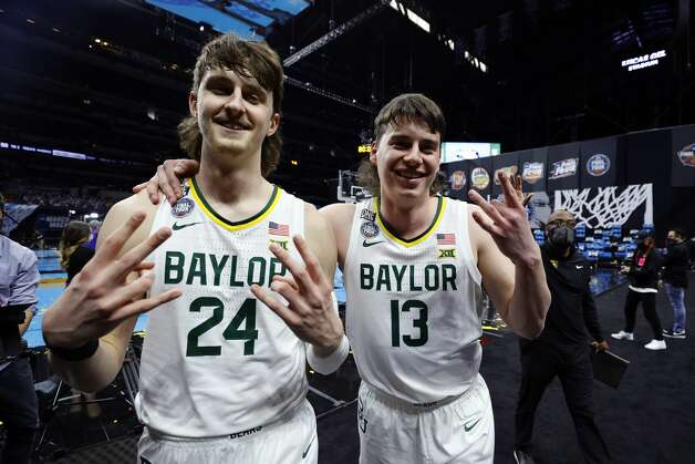 INDIANAPOLIS, INDIANA - APRIL 03: Matthew Mayer #24 and Jackson Moffatt #13 of the Baylor Bears celebrate defeating the Houston Cougars 78-59 in the 2021 NCAA Final Four semifinal to advance to the National Championship game at Lucas Oil Stadium on April 03, 2021 in Indianapolis, Indiana. (Photo by Tim Nwachukwu/Getty Images) Photo: Tim Nwachukwu/Getty Images / 2021 Getty Images