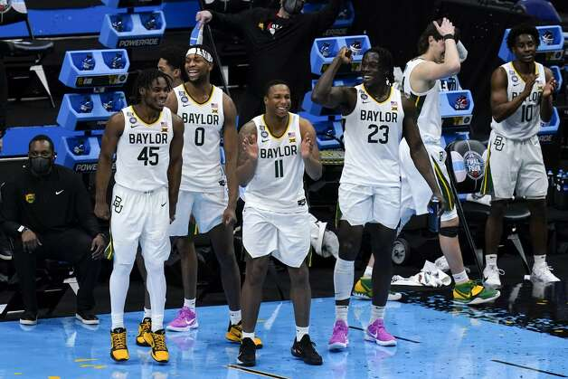 Baylor players celebrate at the end of a men's Final Four NCAA college basketball tournament semifinal game against Houston, Saturday, April 3, 2021, at Lucas Oil Stadium in Indianapolis. Baylor won 78-59. (AP Photo/Michael Conroy) Photo: Michael Conroy/Associated Press / Copyright 2021 The Associated Press. All rights reserved.